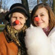 Stock Photo: Portrait of Granddaughter and granny with clown noses rest in au