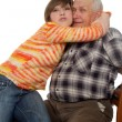 Stock Photo: Happy grandchild hugs happy grandad