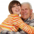 Happy grandchild hugs a happy grandad - Stock Photo