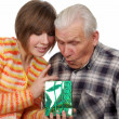 Grandfather and granddaughter with present — Stock Photo