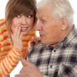 Stock Photo: Grandad and granddaughter gossiping