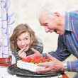 Grandfather with granddaughter — Stock Photo #8885407