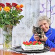 Elderly woman with cat — Stock Photo