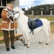 Stock Photo: Granny with pony outdoor