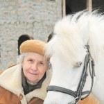 Elderly woman near pony — Stock Photo #8885676