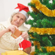 Granny with Christmas stocking — Stock Photo