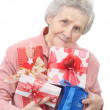 Old lady and boxes with gifts - 图库照片