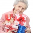 Old lady and boxes with gifts - Stockfoto