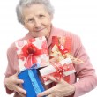 Old lady and boxes with gifts - Stock Photo