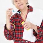 Senior lady blowing soap bubbles — Stock Photo