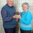 Stock Photo: Happy old couple with natural flowers