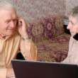 Senior couple gossip about something by phone — Stock Photo