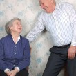 Happy old couple laugh until one cries - Foto Stock