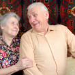 Stock Photo: Seventy year old couple smiling at home