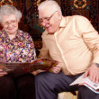Senior couple read the news - Stock Photo