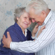 Happy senior couple embrace each other - Stock Photo