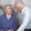 Stock Photo: Senior couple play fool