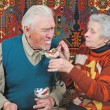 Royalty-Free Stock Photo: Old woman feed old man