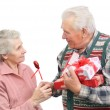 Stock Photo: Senior men give gifts