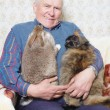 Old man hold animal — Stock Photo