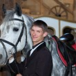 Young rider with race-horse — Stockfoto
