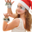 Pretty girl with christmas toys — Stock Photo