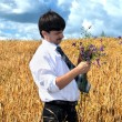 Businessman picks flowers fron field — Stock Photo