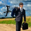 Young successful businessman takes his work to field — Stock Photo