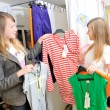 Pretty girls pick out clothes to buy — Stock Photo #8888398
