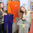 Girls pick out clothes to buy — Stock Photo #8888399