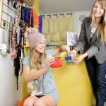 Seller girl gives to a customer bonus-sweets — Stock Photo #8888411