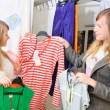 Girls pick out clothes to buy — Stock Photo