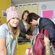 A man buying clothes to young girl — Stock Photo