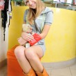 Beautiful smiling young girl in hat holds teddy bear on laps — Стоковая фотография