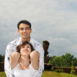 Happy young beautiful couple outdoors in village — Stock Photo #8888830