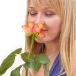Stock Photo: Portait of beauty girl smelling rose