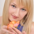 Portrait of young beautiful blond girl with pink rose — Stock Photo #8888865