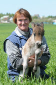 Woman with foal pony — Stock Photo