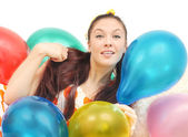 Girl with balloons look at camera — Stock Photo