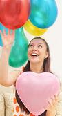 Girl and balloons — Stock Photo