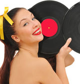 Beauty smiling young woman with vinyl discs — Stock fotografie