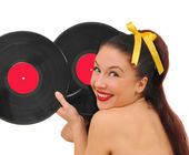 Happy smiling young woman with vinyl plate — Stock Photo