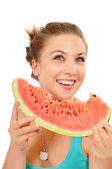 Smiling young woman eating watermelon — Stock Photo