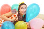 Cute girl among ballons — Stock Photo