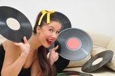 Girl music lover with vinyl discs — Stock Photo