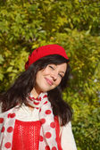 Laughing girl in red beret looking at camera — Stock Photo