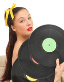 Nice girl with vinyl disks look at camera — Stock Photo
