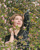 Portrait girl on the flowering apple-tree background — Stock Photo