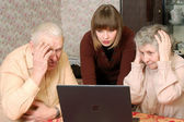 Grandparents and granddaughter looking in wide-eyed astonishmen — Stock Photo
