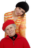 Grandmother and granddaughter with berets — Stock Photo